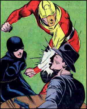 Scarlet delivers a left as Blackie looks on. Artist: George Tuska.
