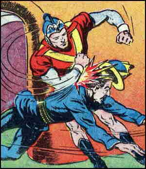 Ultra Man socks it to a foe. Artist: Jon L. Blummer.
